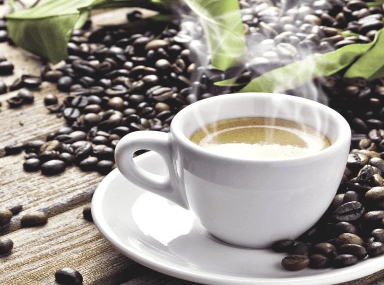 coffee beans surrounded mug