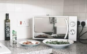 a microwave on the table with two plates