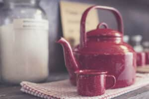 red tea kettle on the table