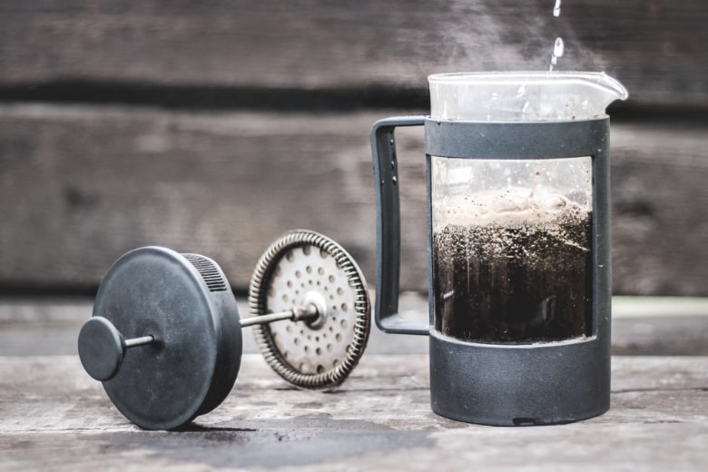 french press with coffee outdoor