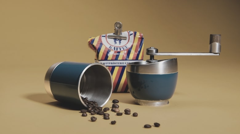 manuel coffee grinder with yellow back ground