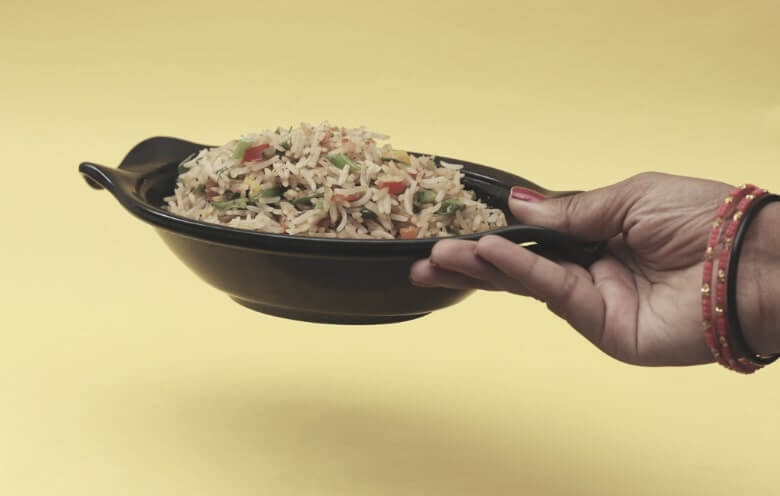 holding rice in a plate