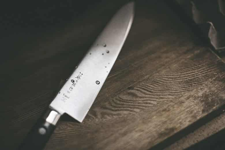 very sharp knife on cutting board