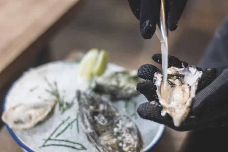 opening a oyster with knife