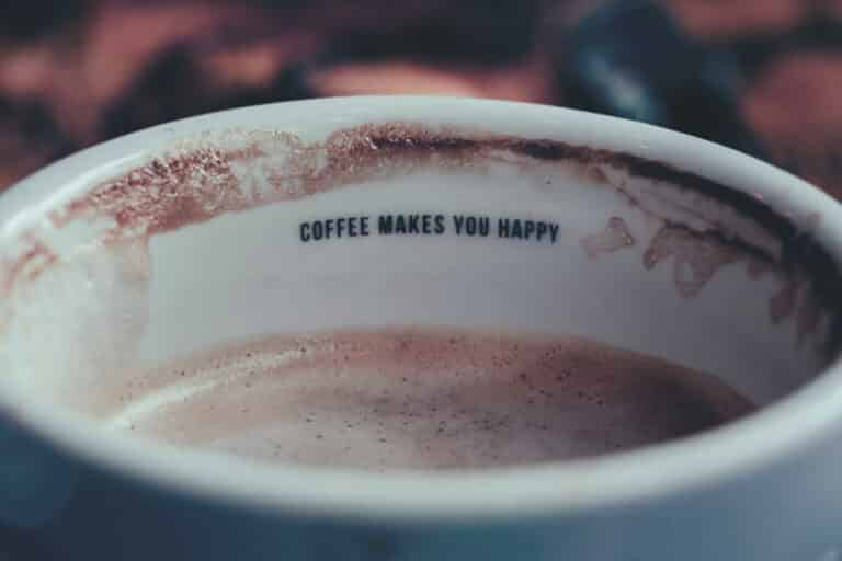 coffee makes you happy is written in the cup of coffee