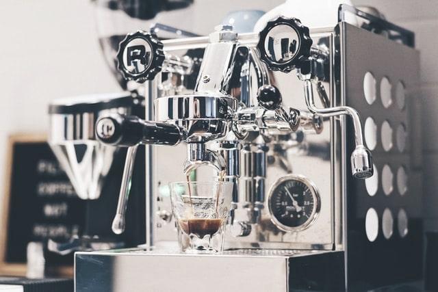 silver espresso machine making coffee